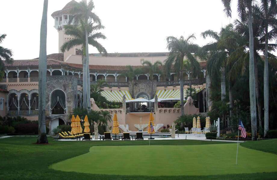 FILE - This Saturday, April 15, 2017, file photo shows President Donald Trump's Mar-a-Lago estate in Palm Beach, Fla. President Trump's decision to pull out of the Paris climate agreement could accelerate damage to his family's real estate empire in the coming decades, especially his properties that lie just feet from the encroaching sea in low-lying South Florida. Projections from the National Oceanic and Atmospheric Administration show that Trump's Mar-a-Lago estate, the apartment towers bearing his name on Miami-area beaches and his Doral golf course are all threatened by rising seas. (AP Photo/Alex Brandon) Photo: Alex Brandon, STF / Copyright 2017 The Associated Press. All rights reserved.