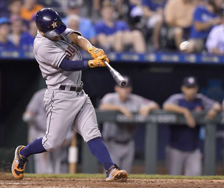 The Houston Astros' Jose Altuve connects on a two-run home run in the ninth inning against the Kansas City Royals at Kauffman Stadium in Kansas City, Mo., on Thursday, June 8, 2017. (John Sleezer/Kansas City Star/TNS) Photo: John Sleezer/TNS