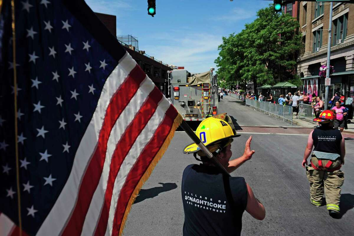 Dana Vanburen, captain of the Schaghticoke Fire Department, along with other members of his department, march in the 47th Annual Troy Flag Day Parade on Sunday, June 8, 2014, in Troy, N.Y. (Paul Buckowski / Times Union)