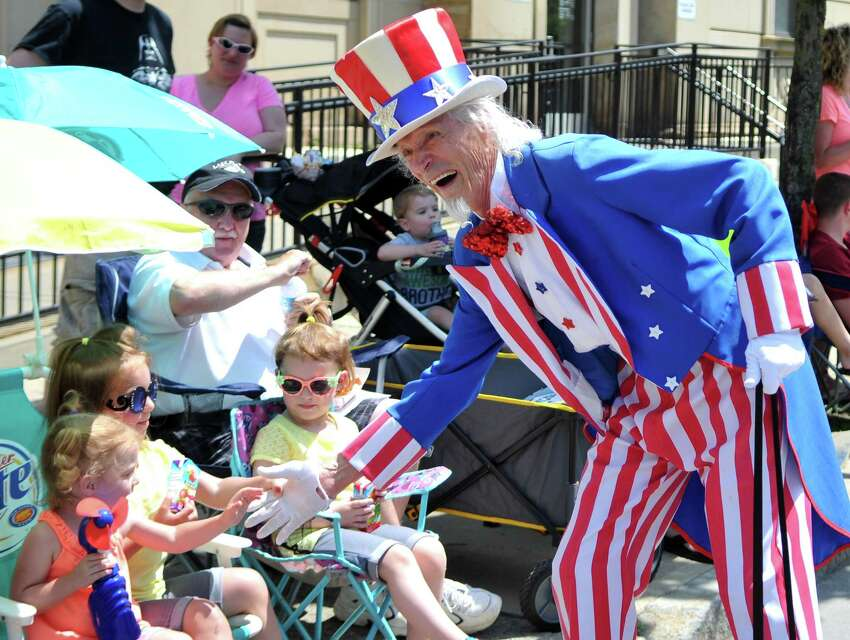 Uncle Sam shakes hands with parade viewers during the 48th Troy Flag Day Parade Sunday, June 14, 2015, in Troy, N.Y. (Phoebe Sheehan/Times Union archive)