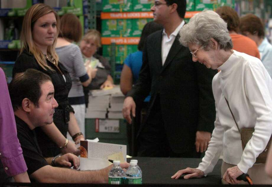 "Betty Barone, of Hamden, gets an autograph from Chef Emeril Lagasse during a signing event for his new book ""Farm to Fork,"" Tuesday June 8, 2010 at BJ's Wholesale Club in Fairfield. Photo: Autumn Driscoll / Connecticut Post"