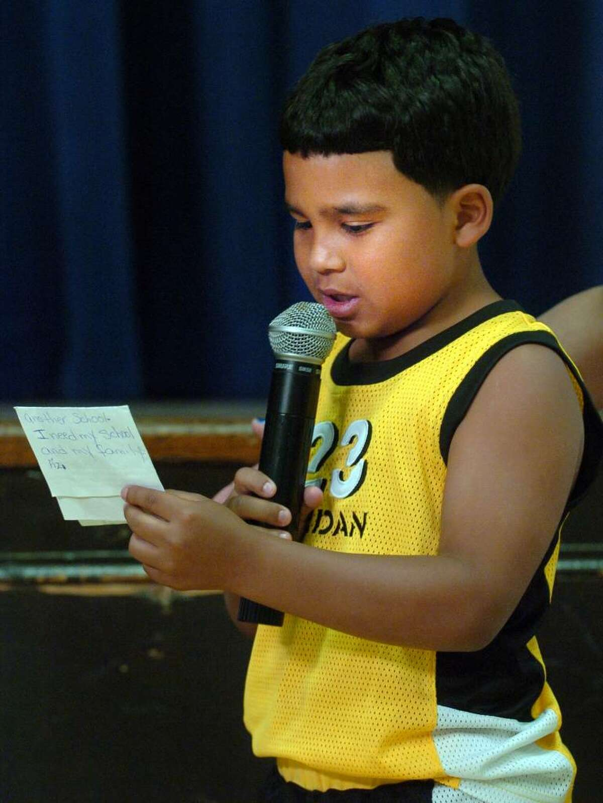 Roosevelt School second-grader Luis Reyes reads a note to Superintendent of Schools John Ramos Tuesday June 8, 2010 during a meeting to discuss plans to close the school as part of a budget cutting measure.