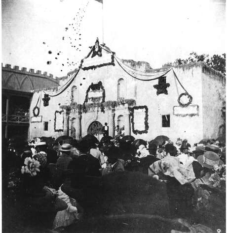 Celebration in front of a decorated Alamo in the 1890s. Photo: Courtesy San Antonio Conservation Society