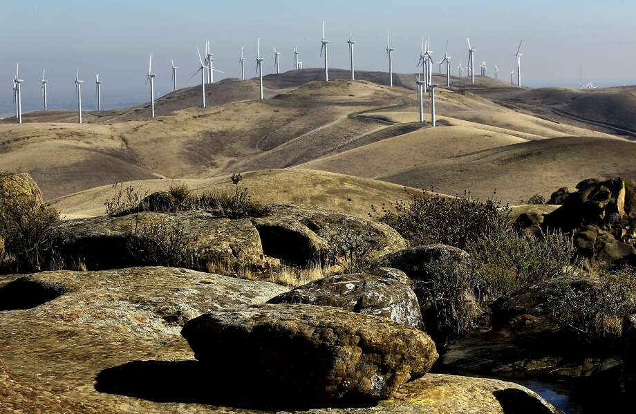 A wind farm on Monday Dec. 9, 2013, that sits on newly acquired property by the East Bay Regional Park District as seen from the Vasco Caves Regional Park, in the Altamont Pass near Livermore, Ca. Photo: Michael Macor, The Chronicle