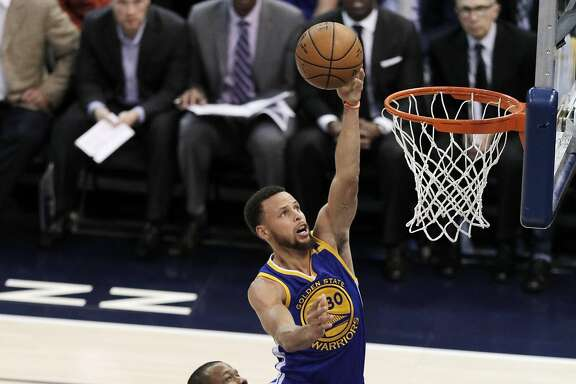 Stephen Curry (30) puts in a layup in the first half as the Golden State Warriors played the Utah Jazz at Vivint Smart Home Arena in Salt Lake City, Utah, on Monday, May 8, 2017, in Game 4 of the 2017 Western Conference Semifinals. The