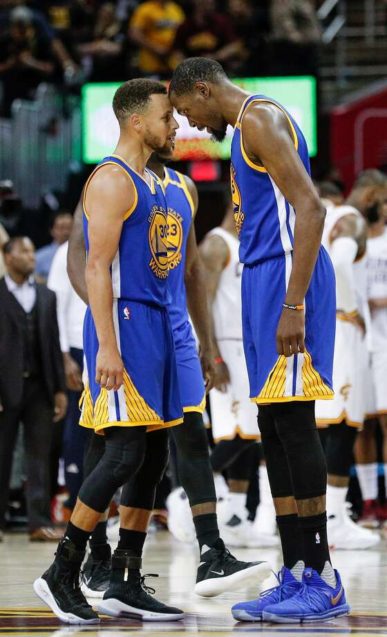 Golden State Warriors' Stephen Curry and Kevin Durant touch heads in the fourth quarter during Game 3 of the 2017 NBA Finals at Quicken Loans Arena on Wednesday, June 7, 2017 in Cleveland, Ohio Photo: Carlos Avila Gonzalez, The Chronicle