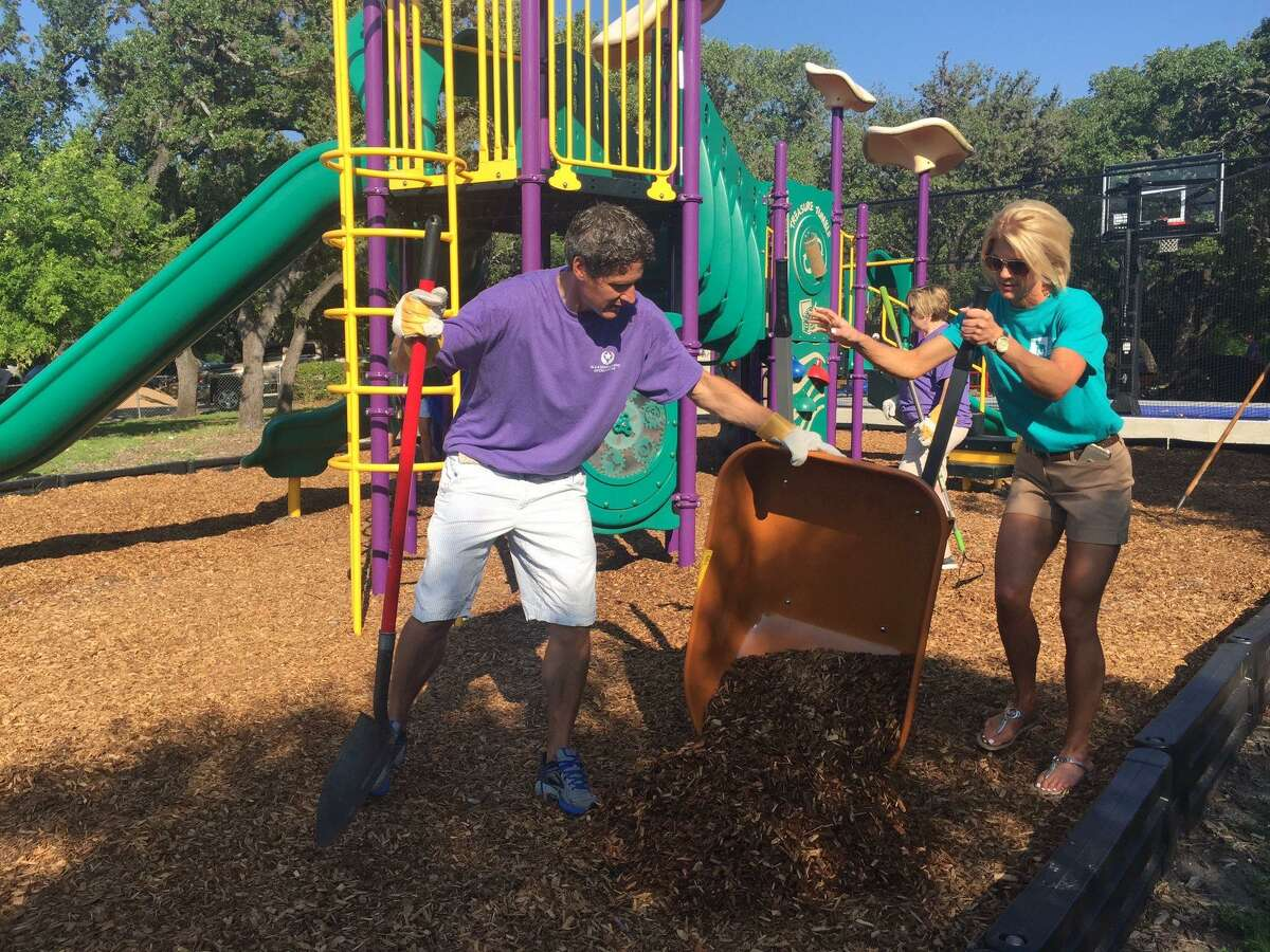 Volunteers help build a playground for the Children's Shelter Residential Treatment Campus.