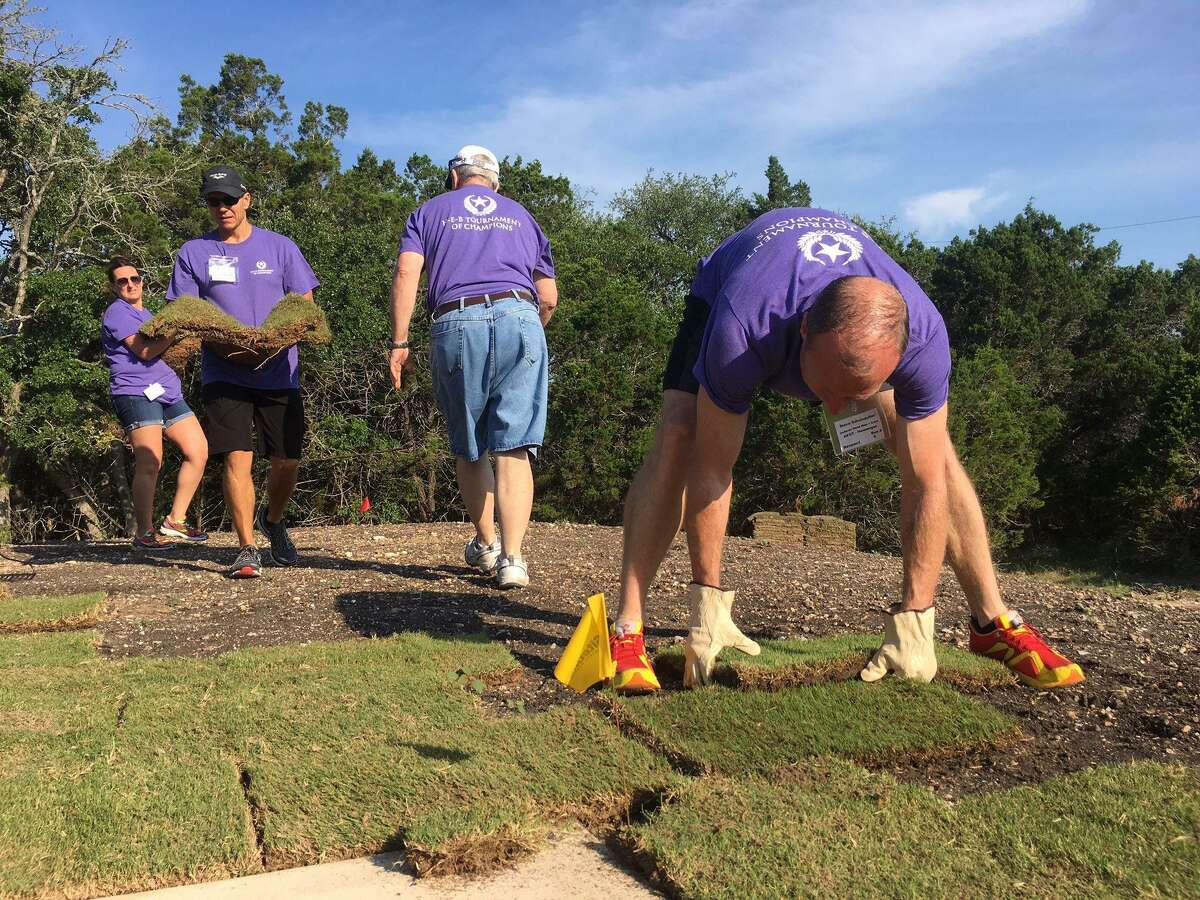 Volunteers help with landscaping at the SAMMinistries Transitional Living Center.