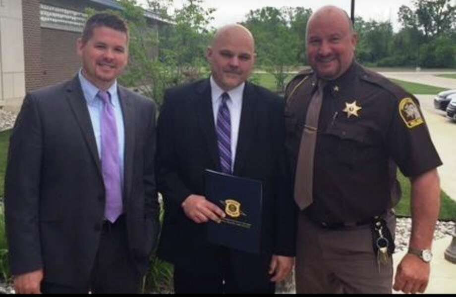 Midland County Sheriff's Office Detectives Scott Holzinger and Brent Benzing, with Sheriff Scott Stephenson.