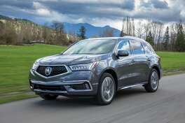 The 2017 Acura MDX Sport Hybrid uses the same basic powertrain as the NSX, though not as powerful. Total system horsepower is 321, with 289 lb.-ft. of torque. Its fuel economy works out to 26/27/27 mpg.