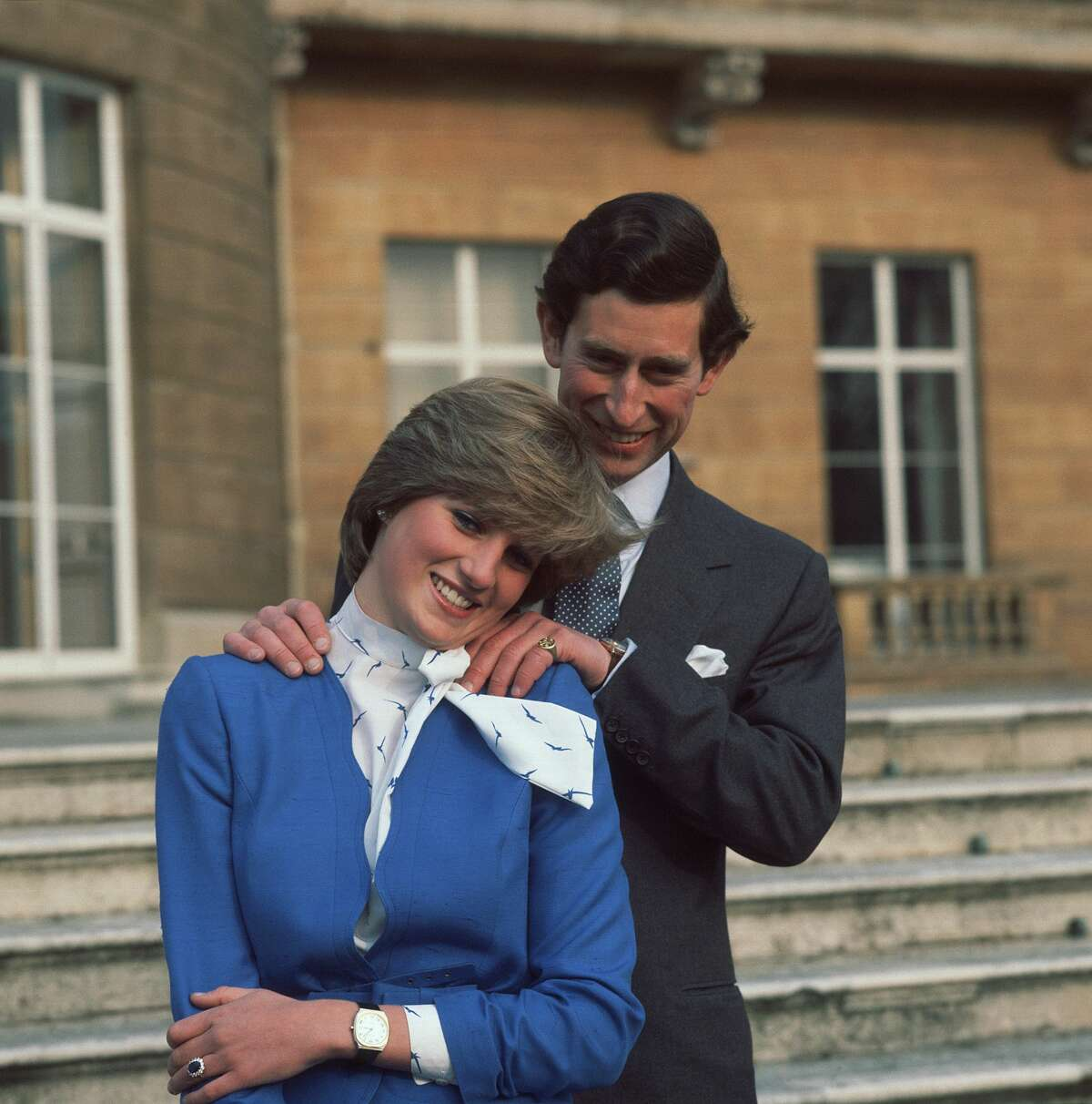 Prince Charles and Lady Diana Spencer pose for photographers at Buckingham Palace after the announcement of their engagement.