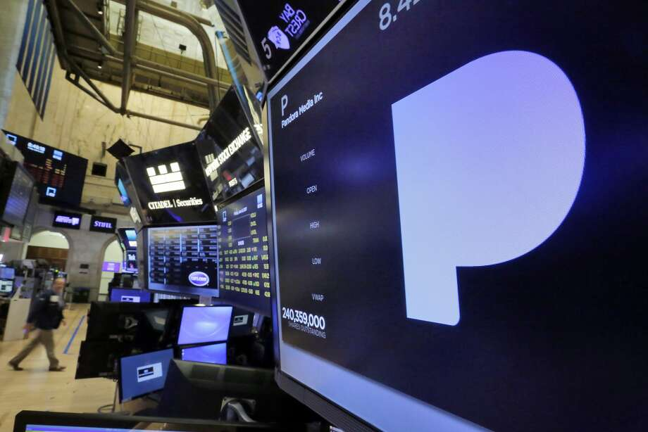 Pandora Media's name and logo appear above a trading post on the floor of the New York Stock Exchange. Photo: Richard Drew, Associated Press