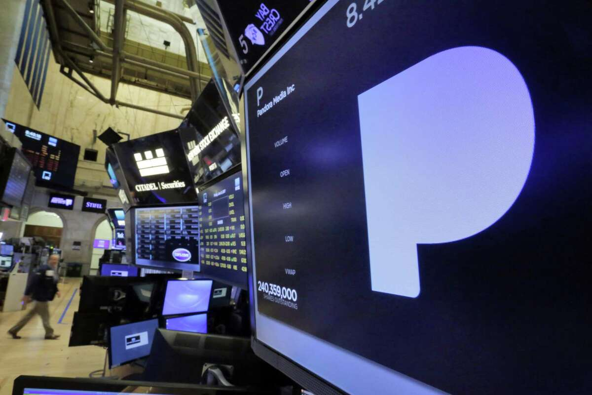 The Pandora Media name appears above a trading post on the floor of the New York Stock Exchange on Friday. The online music service is selling a nearly 20 percent stake to satellite radio company Siriuus XM for $480 million.
