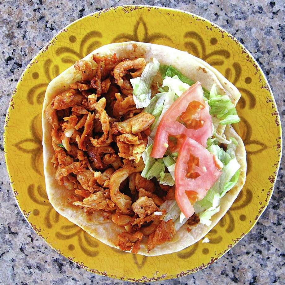 Chicken fajita taco on a handmade flour tortilla from Taquería La Perla de Jalisco. Photo: Mike Sutter /San Antonio Express-News