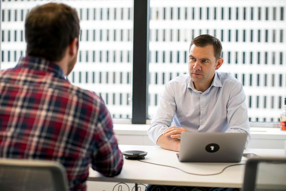 CEO of OneLogin, Thomas Pedersen, talks to Customer Success Manager, Mitchell Ashcroft, in his office before a client call in San Francisco, Calif. Thursday, June 8, 2017.