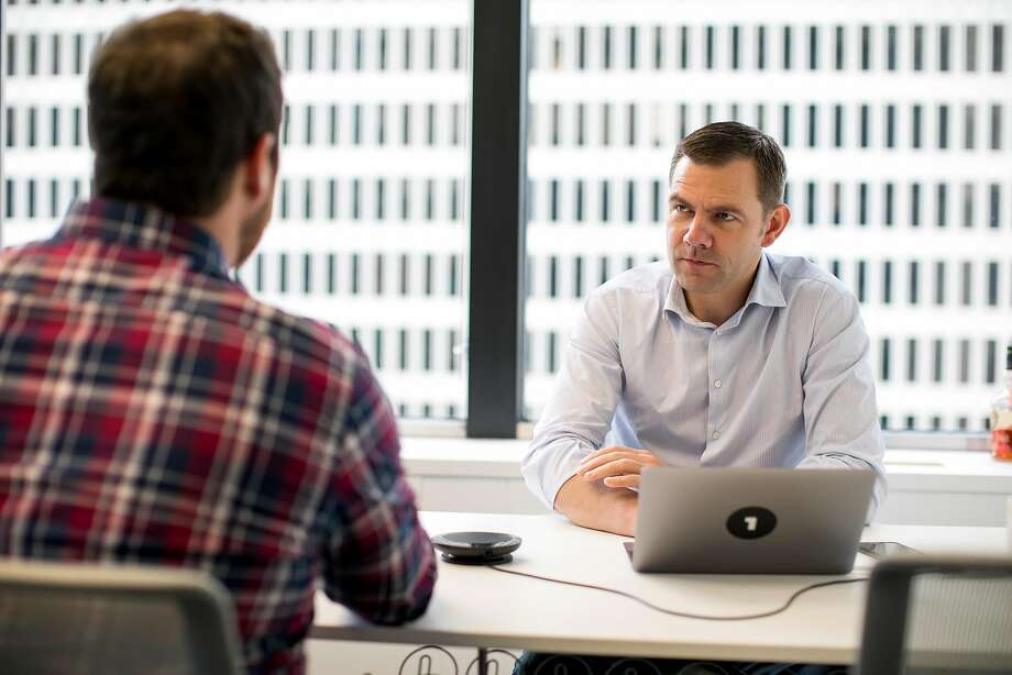 OneLogin CEO Thomas Pedersen (right) talks with Customer Success Manager Mitchell Ashcroft in his office before a client call. Photo: Mason Trinca, Special To The Chronicle