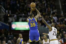Golden State Warriors forward Kevin Durant (35) shoots over Cleveland Cavaliers forward LeBron James (23) during the second half of Game 3 of basketball's NBA Finals in Cleveland, Wednesday, June 7, 2017. Golden State won 118-113 (AP Photo/Tony Dejak)