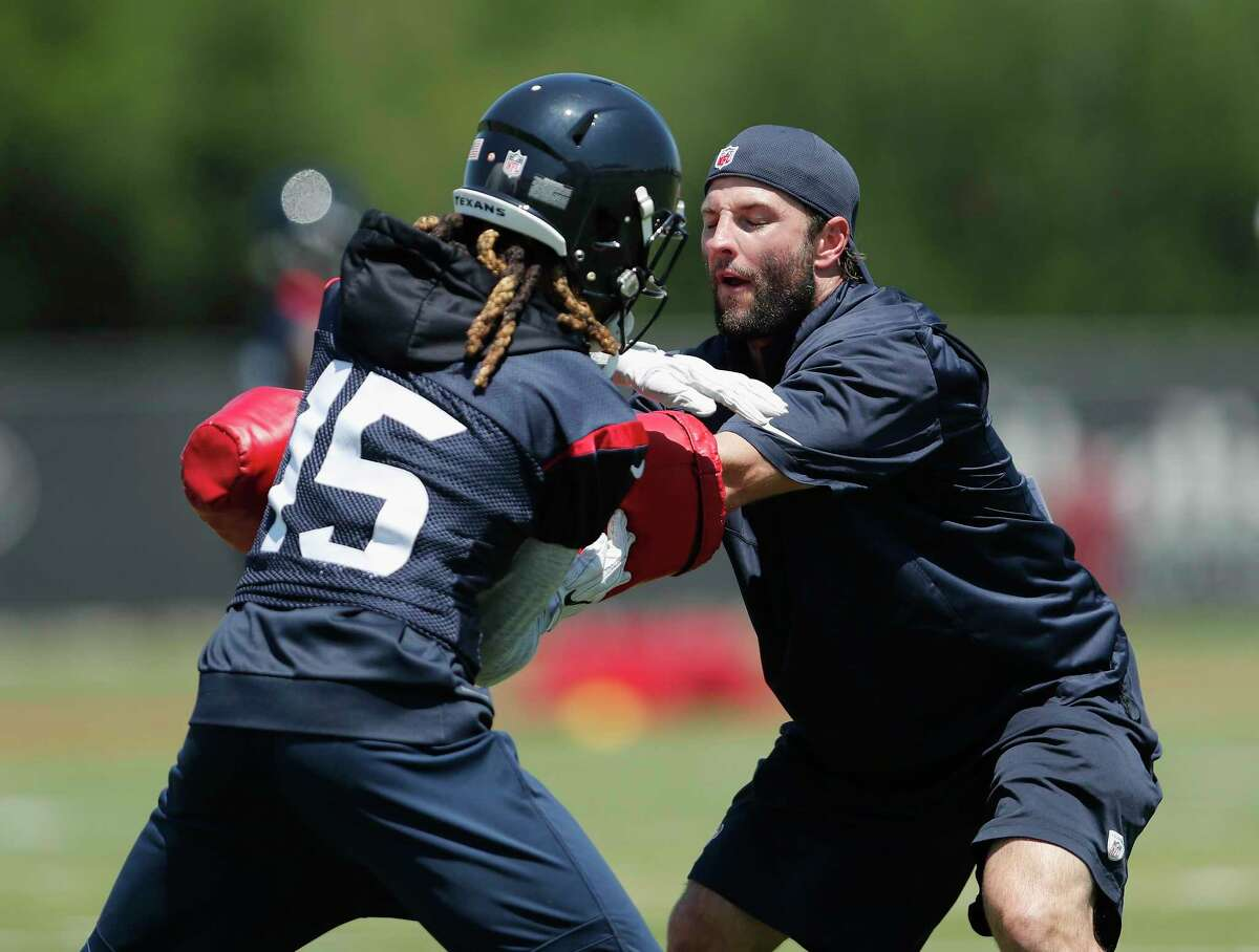 Offensive and special teams assistant coach Wes Welker runs a drill with Houston Texans wide receiver Will Fuller (15) during the Houston Texans OTAs at the Methodist Training Center in Houston, TX on Tuesday, May 23, 2017.