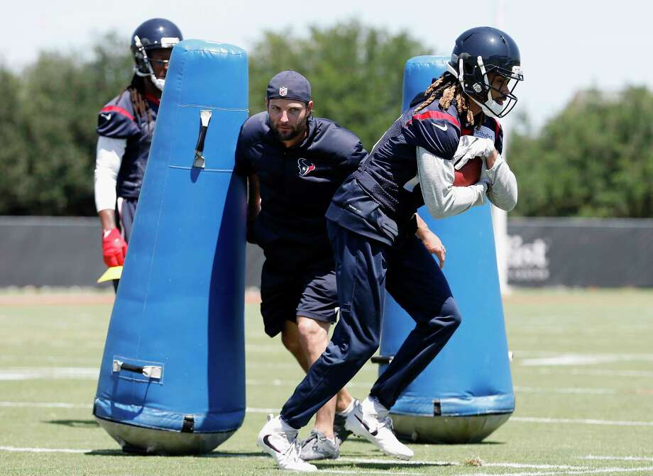 Offensive and special teams assistant coach Wes Welker attempts to strip the ball from Houston Texans wide receiver  Will Fuller (15) during the Houston Texans OTAs at the Methodist Training Center in Houston, TX on Tuesday, May 23, 2017. Photo: Tim Warner, Freelance / Houston Chronicle
