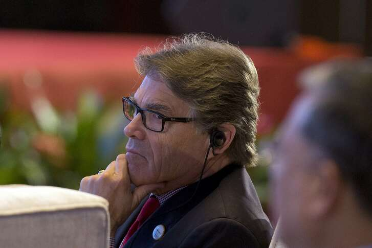 In this photo taken Wednesday, June 7, 2017, U.S. Energy Secretary Rick Perry attends the opening ceremony of an international clean energy conference held in Beijing, China. Energy ministers from around the world gathered in Beijing this week to report increased spending to help counter climate change. Yet one prominent voice, that of U.S. Energy Secretary Rick Perry, delivered a starkly countervailing message as the Trump administration seeks to roll back spending on clean energy and promote fossil fuels. (AP Photo/Ng Han Guan)