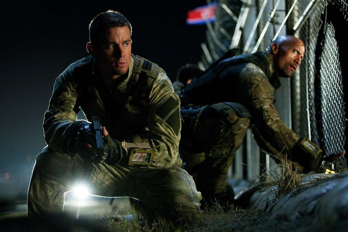 """This publicity photo released by Paramount Pictures shows Channing Tatum, left, as Duke and Dwayne Johnson as Roadblock in a scene from the film, """"G.I. Joe: Retaliation."""" Since the popularity of the �Transformers� franchise, Hollywood has increasingly turned to Hasbro toys like �G.I. Joe� and �Battleship� to capitalize on their familiar brands, even though crafting an actual story based on kid playthings requires more than a little assembly. (AP Photo/Paramount Pictures, Jaimie Trueblood)"""