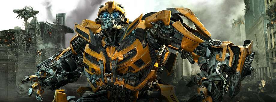 """In this publicity image released by Paramount Pictures, Bumblebee is shown in a scene from """"Transformers: Dark of the Moon."""" Since the popularity of the """"Transformers"""" franchise, Hollywood has increasingly turned to Hasbro toys like """"G.I. Joe"""" and """"Battleship"""" to capitalize on their familiar brands, even though crafting an actual story based on kid playthings requires more than a little assembly. (AP Photo/Paramount Pictures) Photo: Paramount Pictures, Associated Press"""