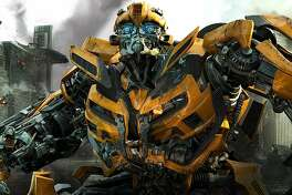 """In this publicity image released by Paramount Pictures, Bumblebee is shown in a scene from """"Transformers: Dark of the Moon."""" Since the popularity of the �Transformers� franchise, Hollywood has increasingly turned to Hasbro toys like �G.I. Joe� and �Battleship� to capitalize on their familiar brands, even though crafting an actual story based on kid playthings requires more than a little assembly.  (AP Photo/Paramount Pictures)"""