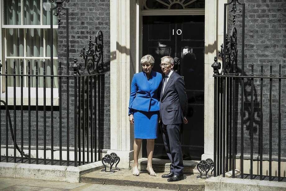 Prime Minister Theresa May enters 10 Downing St. in London with her husband, Philip. Photo: Dan Kitwood, Getty Images