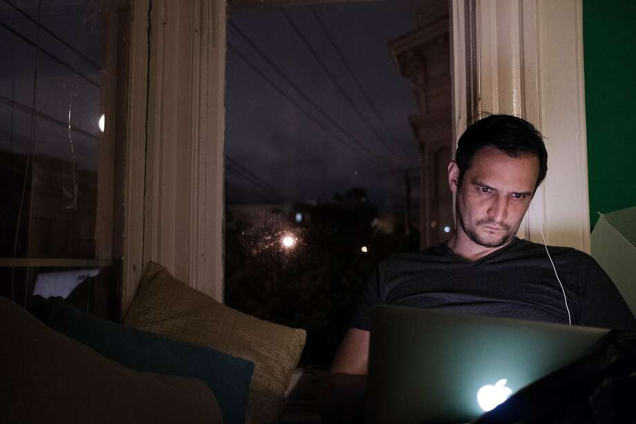 Daniel Kravtsov works on his computer late at night at his home in Hayes Valley. Kravtsov is one of thousands of foreign entrepreneurs who try to make it in the U.S. One potential avenue for startup founders like him to stay longer and build their companies, the International Entrepreneur Rule, has been delayed by the Trump administration, which ultimately plans to scrap it. Photo: Nick Otto, Special To The Chronicle