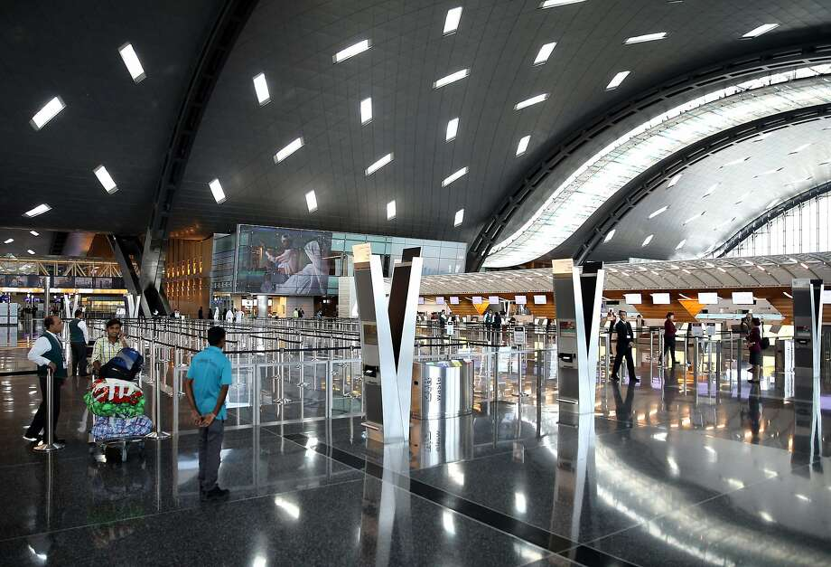 Passengers walk at the Hamad International Airport in Doha on June 7, 2017. A ban on Qatari flights imposed by Saudi Arabia and its allies took effect as first efforts were made to resolve the biggest feud to hit the Arab world in years. Saudi Arabia and allies including Egypt, the United Arab Emirates and Bahrain cut diplomatic ties and transport links with Qatar on June 5, accusing the Gulf state of supporting extremism.  / AFP PHOTO / STRINGERSTRINGER/AFP/Getty Images Photo: STRINGER, AFP/Getty Images