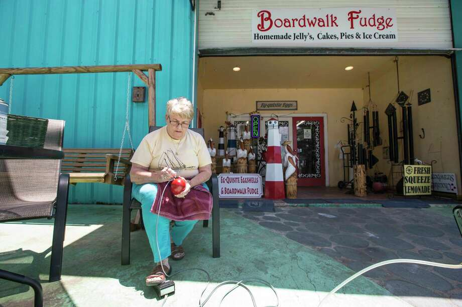 Sandra Williams, owner of Boardwalk Fudge, works on a decorative egg outside her shop on Tuesday, May 30, 2017, in Kemah. ( Brett Coomer / Houston Chronicle ) Photo: Brett Coomer, Staff / © 2017 Houston Chronicle