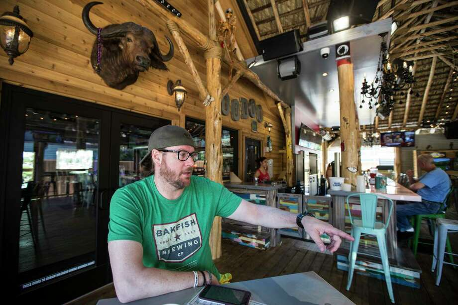 Left: Andrew Moore manages the Voodoo Hut bar, which opened in May. Right: Sandra Williams, owner of Boardwalk Fudge, says the new crowds of customers in Kemah mostly aren't there to buy fudge. Photo: Brett Coomer, Staff / © 2017 Houston Chronicle
