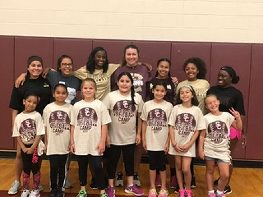 The Summer Creek softball players that help put on the camp with the younger group of campers at the end of the Summer Creek Softball Youth Camp, which ran June 5-7. Photo: Arturo Castillo, Summer Creek Softball