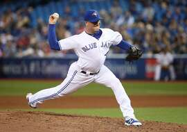 TORONTO, ON - MAY 30: Joe Smith #38 of the Toronto Blue Jays delivers a pitch in the eighth inning during MLB game action against the Cincinnati Reds at Rogers Centre on May 30, 2017 in Toronto, Canada. (Photo by Tom Szczerbowski/Getty Images)
