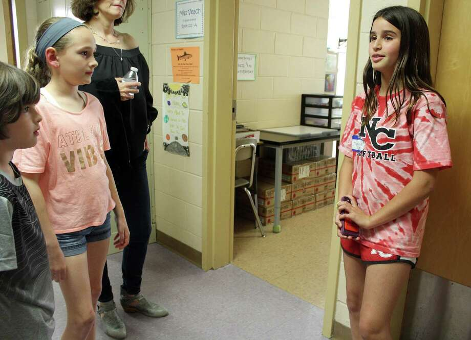 Fourth grader Meara Burke and her younger brother, John, (left) listen to MacKenzie Hart as she gives them a tour of Saxe Middle School in New Canaan, CT on June 2, 2017. Photo: Erin Kayata / Hearst Connecticut Media / New Canaan News