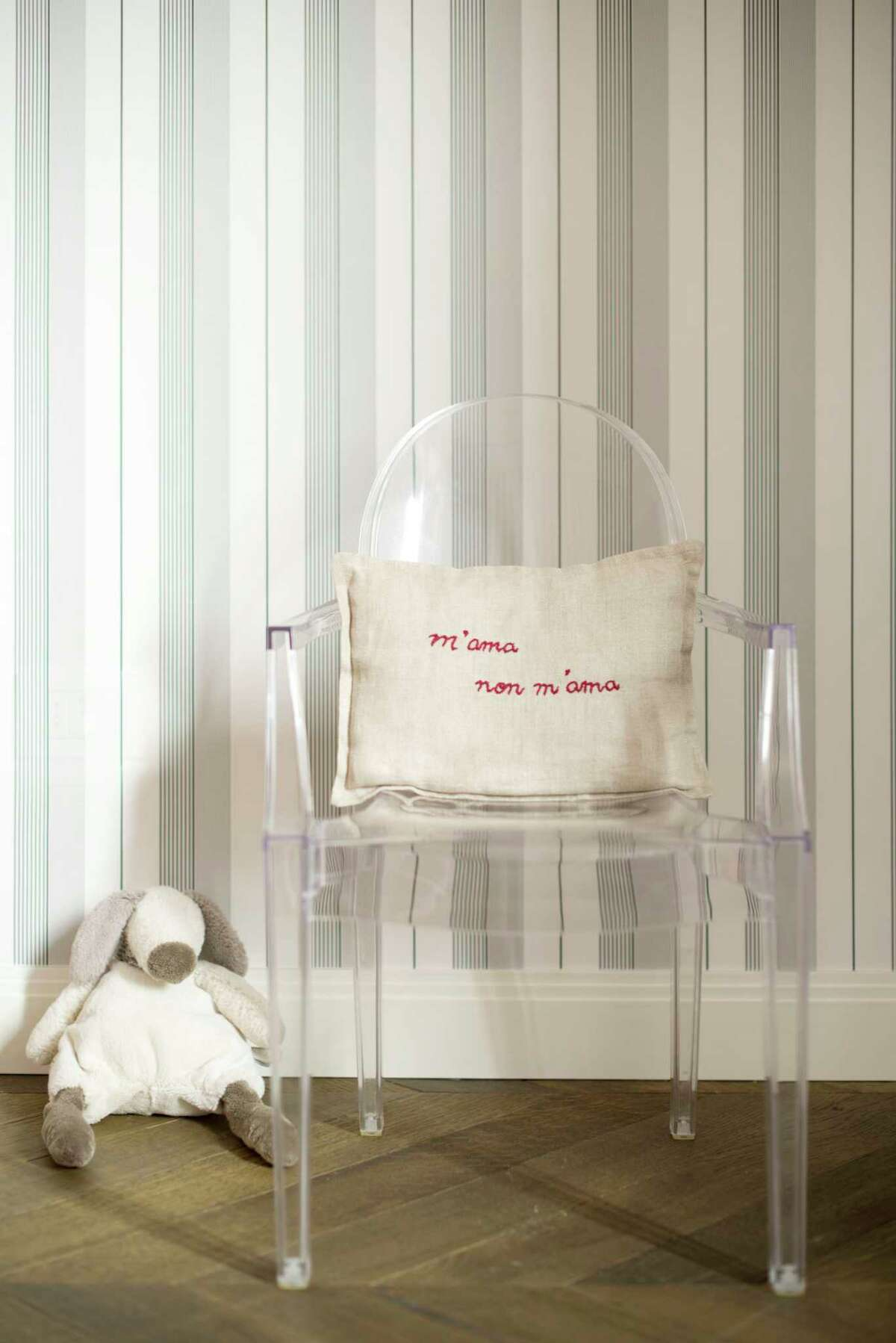 Louis Ghost chair: Kartell's design by Philippe Starck comes in transparent or colored polycarbonate in the style of Louis XV, meant to dazzle and captivate. It may look fragile, but it's stable and durable, and weather-resistant too. at the flagship Kartell Houston, 2013 W. Gray