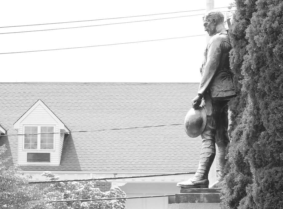 A statue towers above Veterans Green along Myrtle Avenue. Photo: Laura Weiss / Hearst Connecticut Media / Westport News