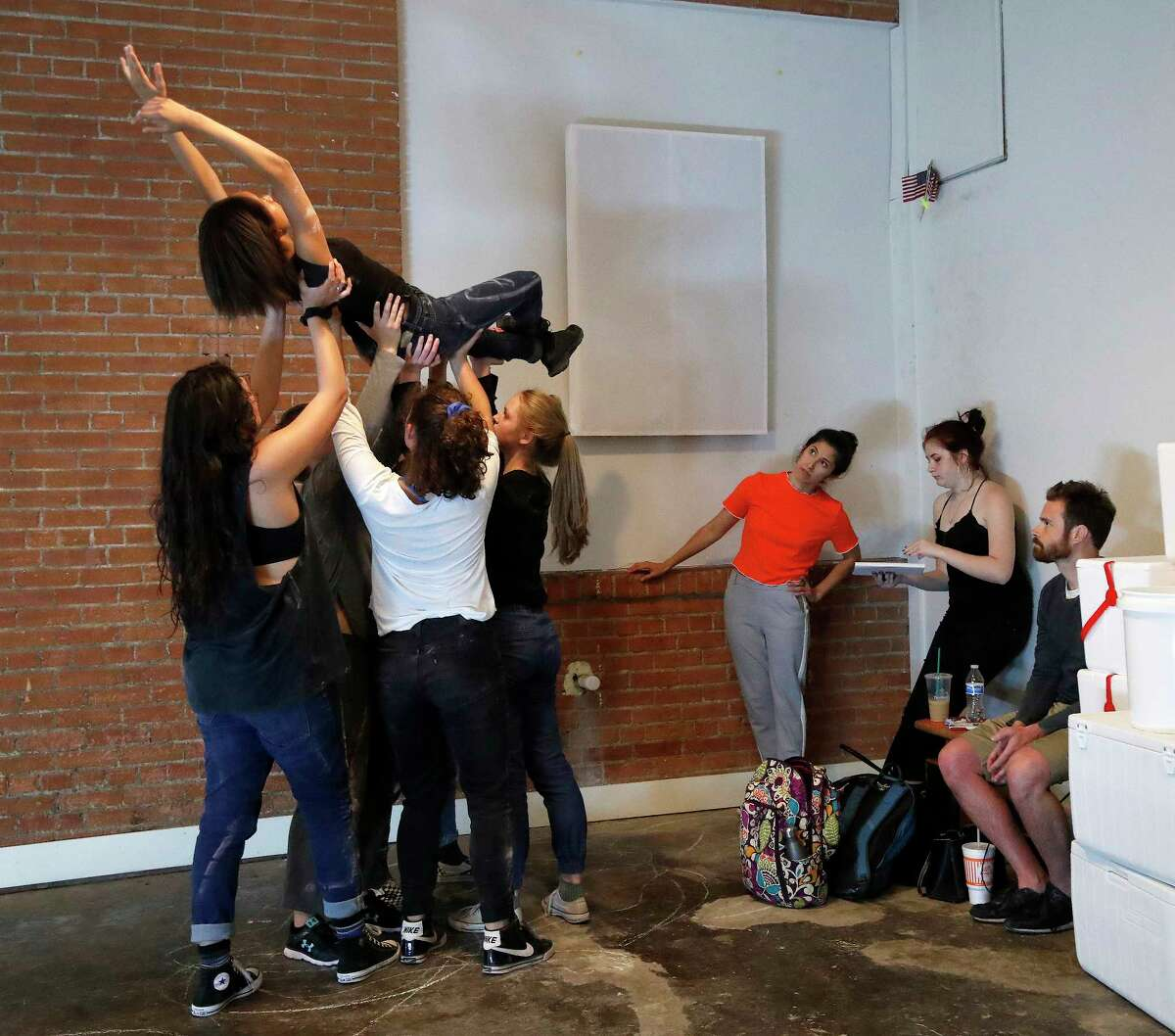 """Choreographer Laura Gutierrez talks to assistant director is Isabella Eleuterius as director Matt Hune watches dancers rehearse a new dance adaptation set to StravinskyÂ?'s """"The Rite of Spring,"""" at the Rec Room downtown, Wednesday, May 31, 2017. ( Karen Warren / Houston Chronicle )"""