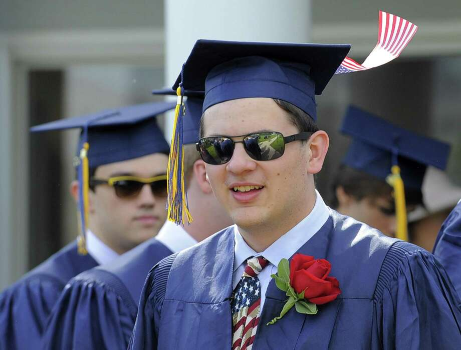 Karl Zoubek, of Westport, sports an American Flag atop his cap as he prepares for King School Class of 2017 Commencement Exercises in Stamford June 2. Photo: Matthew Brown / Hearst Connecticut Media / Stamford Advocate