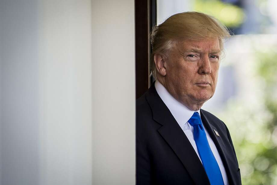 U.S. President Donald Trump stands outside the West Wing of the White House as Klaus Iohannis, Romania's president, not pictured, arrives at the West Wing of the White House in Washington, D.C., U.S., on Friday, June 9, 2017. Trump�said his fired FBI Director�James Comey�showed in Senate testimony on Thursday that Trump hadn't colluded with the Russian government to rig the 2016 election and hadn't obstructed a federal investigation into the meddling. Photographer: Pete Marovich/Bloomberg Photo: Pete Marovich, Bloomberg