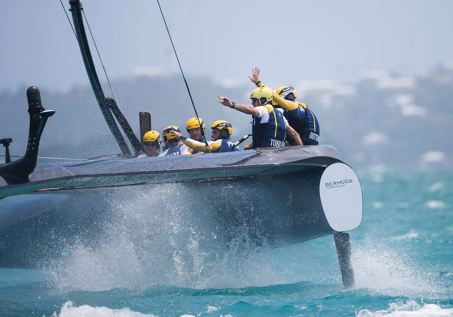 The crew of Sweden's Artemis Racing, skippered by Nathan Outteridge, celebrate winning the challenger semifinals over SoftBank Team Japan. Photo: MARK LLOYD, AFP/Getty Images