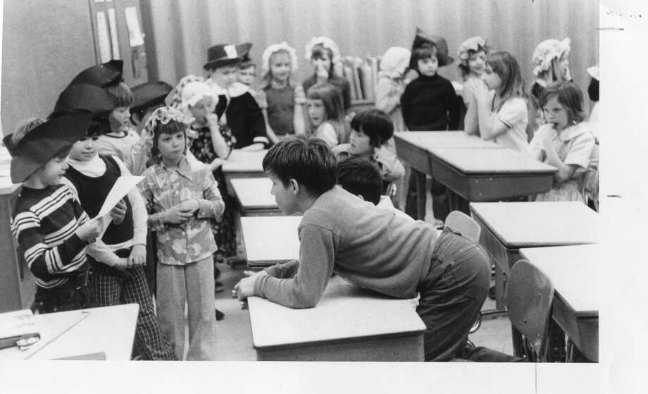 Patrick Biel reads the treaty to the British, which seems to interest Steve Behmlander, right. Chippewassee Elementary. April 1976 Photo: Daily News File Photo