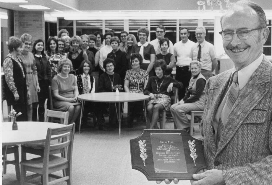 Selected as most outstanding principal of 1971 is Ralph Barr, of Chippewassee Elementary. He was given the award recently by the Michigan Association of Elementary Principals. Barr has been principal at the school for 15 years. In the background are members of the Chippewassee staff. November 1971 Photo: Daily News File Photo