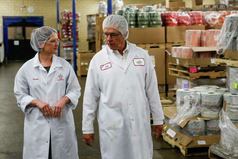 Atkinson Candy Company national marketing manager Sarah Atkinson, left, and her father, Atkinson Candy Company president Eric Atkinson, right, walk through a storage room at the company Wednesday, May 17, 2017 in Lufkin. ( Michael Ciaglo / Houston Chronicle ) Photo: Michael Ciaglo, Staff / Michael Ciaglo