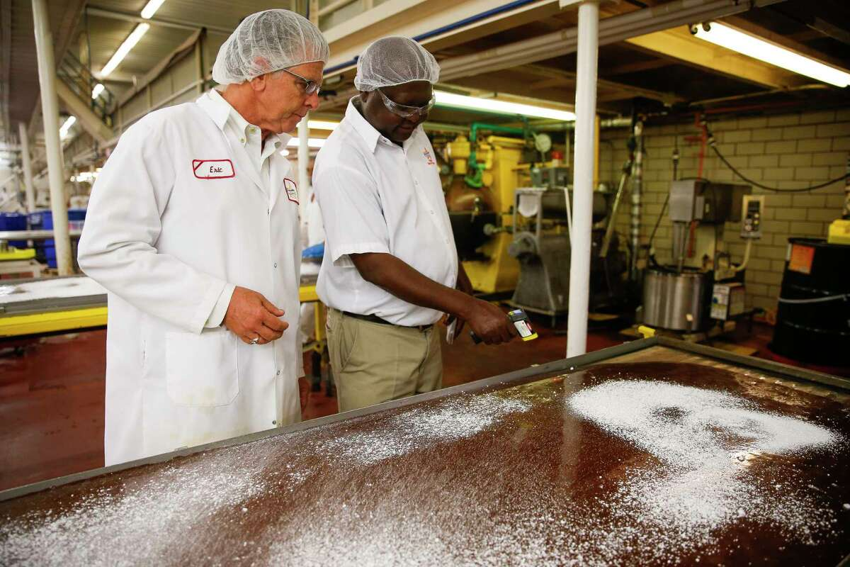 Atkinson Candy Company president Eric Atkinson, left, looks at workers making caramel during a tour of Atkinson Candy Company Wednesday, May 17, 2017 in Lufkin. ( Michael Ciaglo / Houston Chronicle )