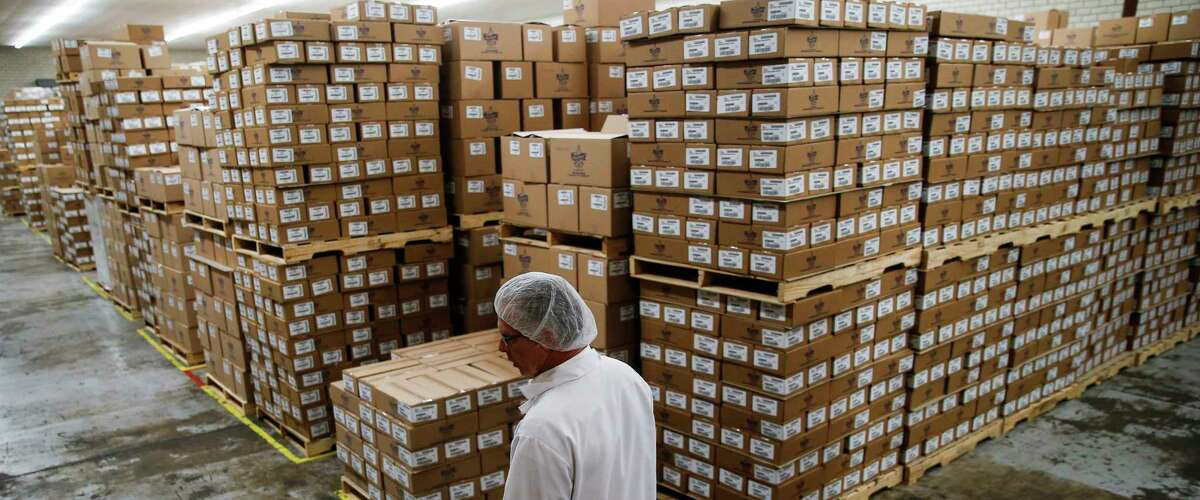 Atkinson Candy Company president Eric Atkinson walks through a storage room at the company Wednesday, May 17, 2017 in Lufkin. ( Michael Ciaglo / Houston Chronicle )