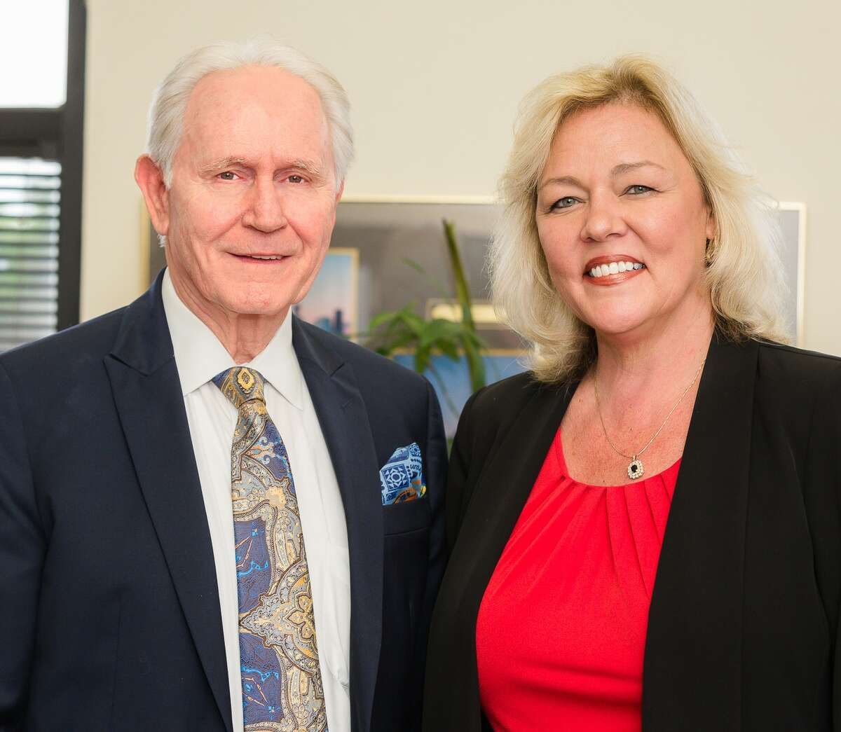 Larry Hill, founder of Sumar Property Management, left, with Terri Clifton, president of Better World Properties.