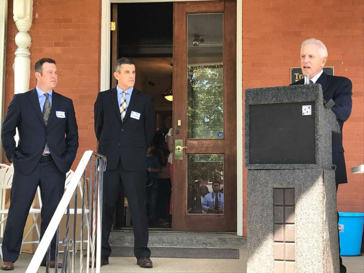 Hartford-based Trantolo & Trantolo held a ribbon cutting Friday for its new location at 944 Fairfield Ave. in Bridgeport, Conn. Pictured from left to right are Scott Trantolo, Keith Trantolo, and their father Vincent Trantolo.