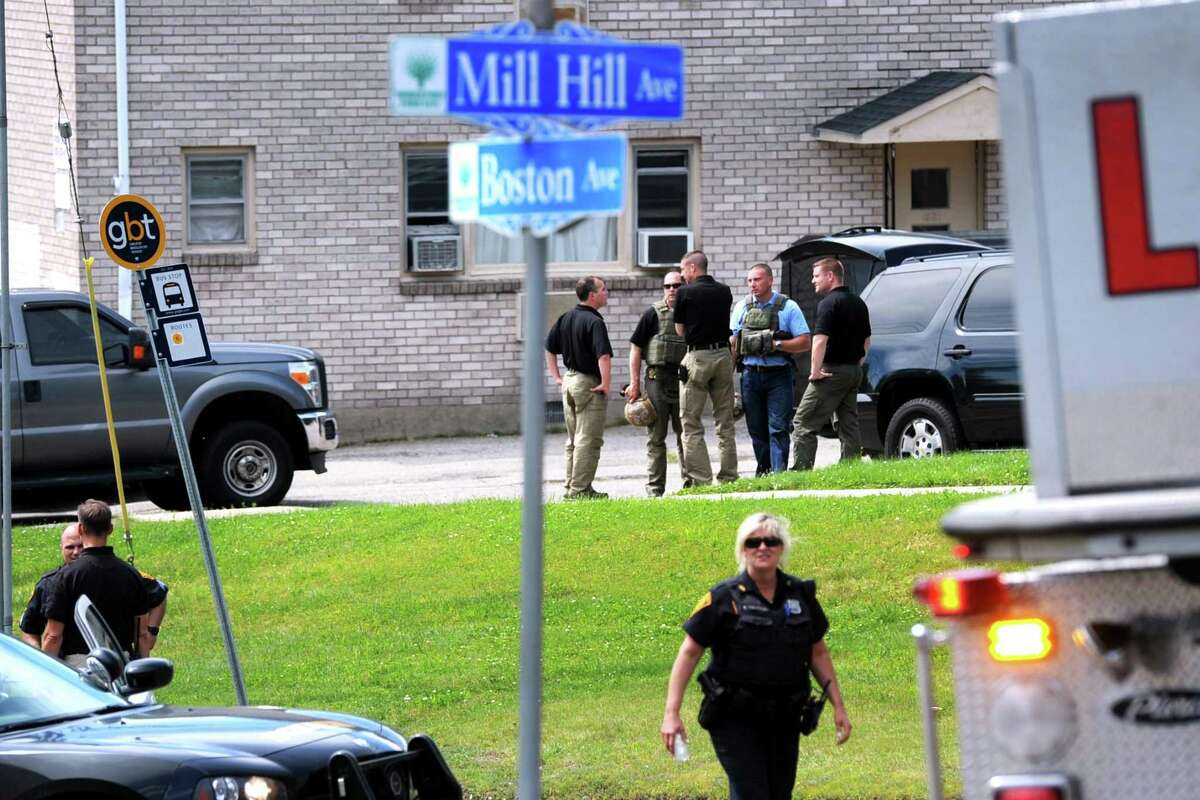 Bridgeport and State Police gather along Boston Ave. after it was closed to traffic due to a reported bomb threat in Bridgeport, Conn. June 9, 2017.