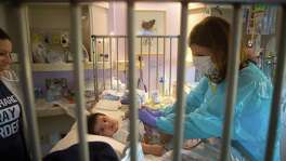Blanca Romero watches as her three-month-old son, Sebastian, is examined by Dr. Sarah Nicholas in Sebastian's isolation room at Texas Children's Hospital, Tuesday, May 23, 2017, in Houston. Sebastian was born with Severe Combined Immunodeficiency Disease, commonly known as SCID, which was identified in his newborn screening. (Mark Mulligan / Houston Chronicle)